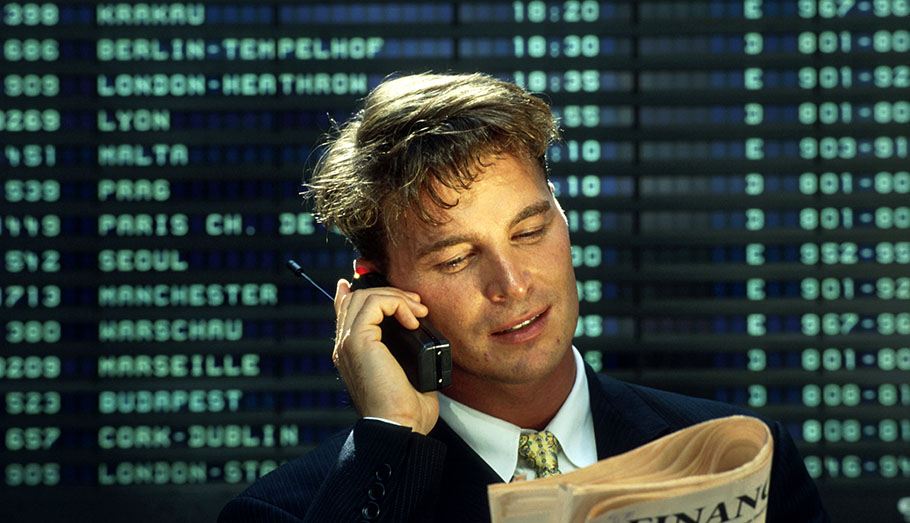 Stock broker on the phone.
